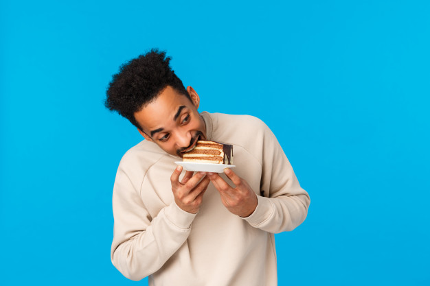 youg man eating cake without any know aphrodisiac effect